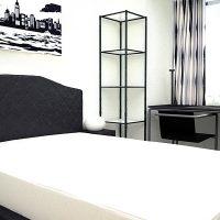 リズム感のあるモノトーンでモダンな寝室インテリア